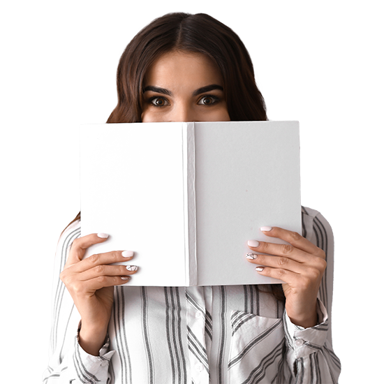 woman peering from behind an open book