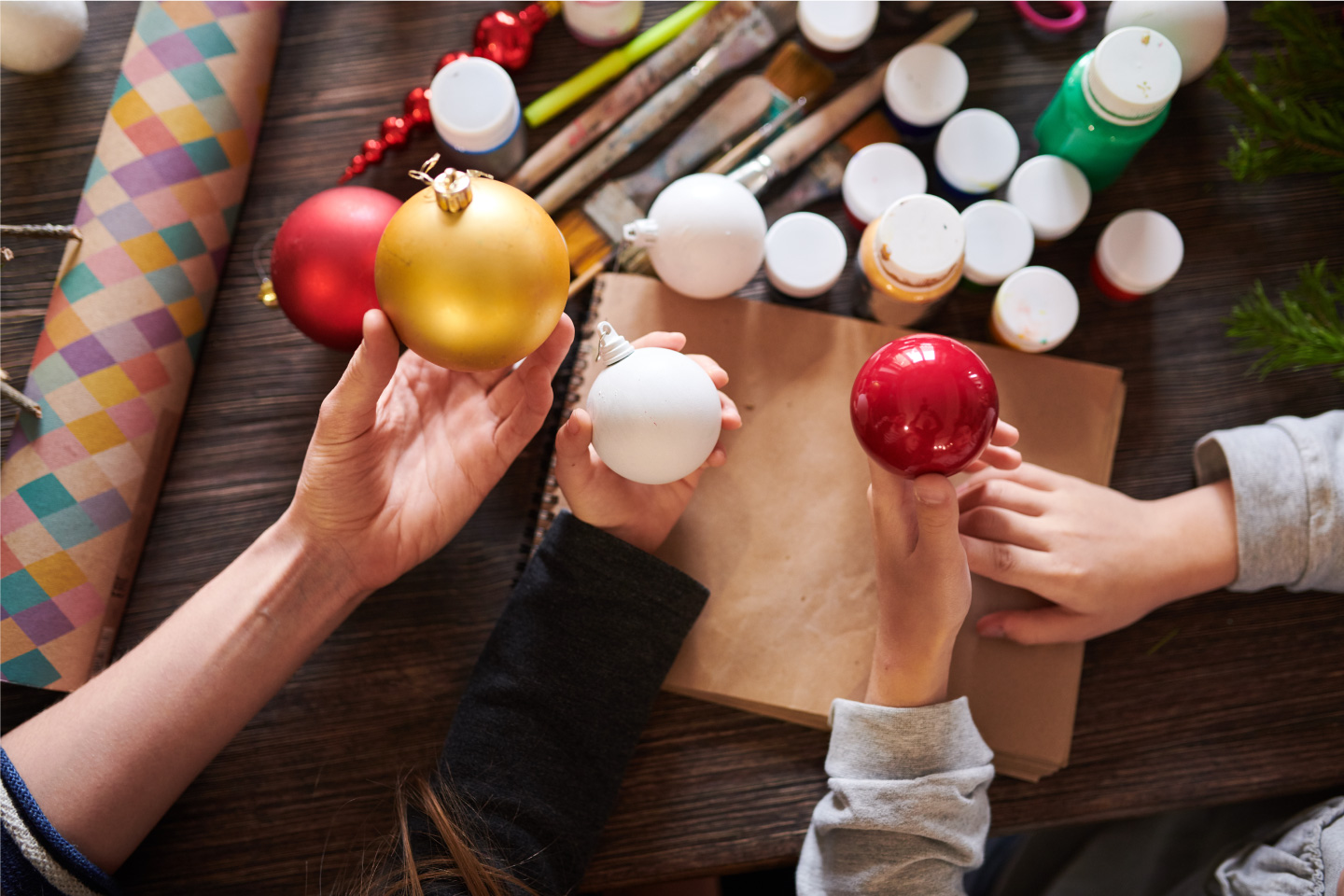 An image of people decorating christmas ornaments