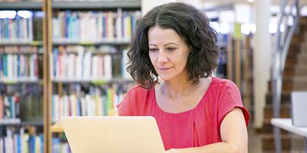 Woman exploring the catalog on laptop.
